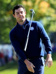 Rory McIlroy of Europe throws his putter on the 18th