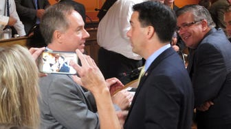 Assembly Speaker Robin Vos (R-Rochester) at right and Gov. Scott Walker.