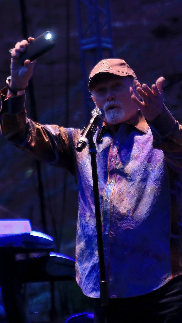 Mike Love encourages the audience to light their cell