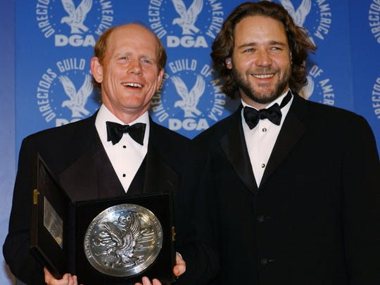 """""""A Beautiful Mind"""" director Ron Howard, left, holds his plaque for Outstanding Directorial Achievement in Feature Films alongside actor Russell Crowe, the star of the film, backstage at the Directors Guild Awards in Los Angeles, Saturday, March 9, 2002."""