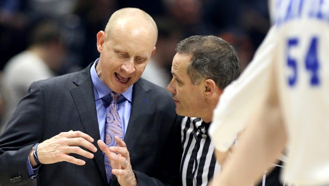Xavier head coach Chris Mack talks with an official after Xavier was called with a foul against Villanova at the Cintas Center Saturday Feb. 17, 2018. Xavier lost 95-79.