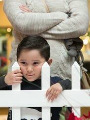 Noah Landavazo, 4, waits in line to see Santa on Tuesday