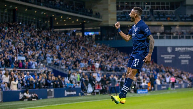 Sporting Kansas City forward Khiry Shelton celebrates in front of a sold-out crowd at Children's Mercy Park after scoring a goal during a 4-0 win over the Houston Dynamo on March 7. Shortly after that match, the entire sports world shut down because of the COVID-19 pandemic, meaning much lost revenue through ticket sales and concessions by Sporting and several MLS teams.