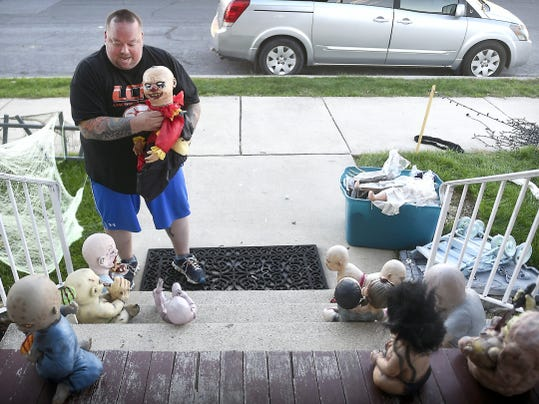 Sean Bankey of Palmyra, here working on a horrific nursery that will decorate his porch and yard for Halloween, is one of 157 million Americans who will celebrate Halloween this year. While 67.8 percent will celebrate by handing out candy, a whopping 44.8 percent will celebrate by decorating the house and yard, according to the National Retail Federation.