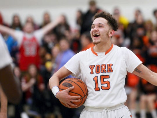 William Penn's Trey Shifflett celebrates in the final moments of the YAIAA boys' basketball tournament championship in February at York College. William Penn beat Central York, 58-45, and later repeated as District 3 Class AAAA champion.