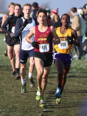 Ithaca's Silas Derfel and Warwick Valley's Behailu Bekele-Arcuri stay close through most of the race during the New York State Cross Country Championships Class A race held at Wayne Central High School.