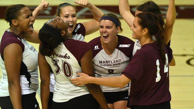 Alana Polk (no. 30) celebrates with her Eastern Shore volleyball teammates after a win in 2015.