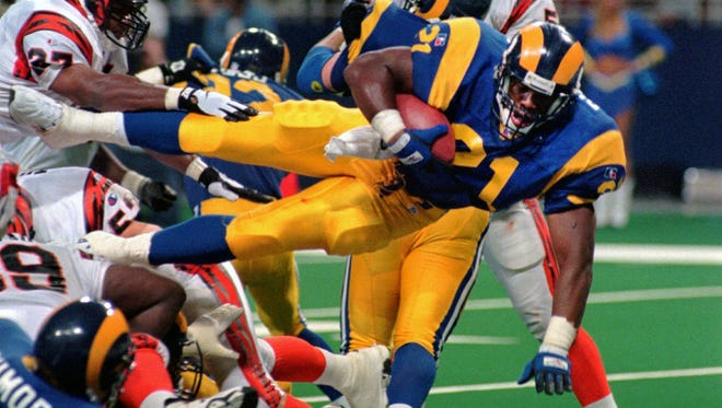 Lawrence Phillips is shown here during his playing days with the St. Louis Rams. Phillips was found dead in his California prison cell early Wednesday, and officials said they suspect suicide.