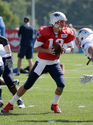 New England Patriots quarterback Tom Brady (12), center, at NFL football training camp, Tuesday, Aug. 1, 2017, in Foxborough, Mass.