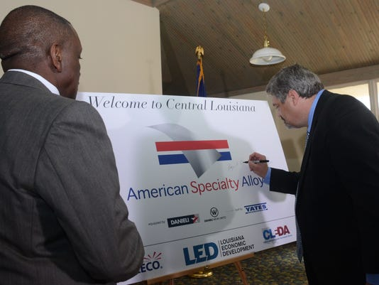 ANI American Specialty Alloys Roger Boggs (right), chairman and CEO of American Specialty Alloys, puts his signature on a sign after a press conference Wednesday, March 3, 2015 announcing that about the $2.4 billion project that will create about 1,400 job