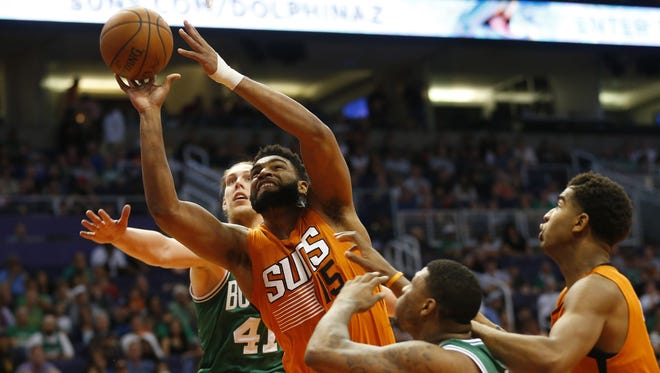 Phoenix Suns forward Alan Williams (15) puts a shot up against Boston Celtics center Kelly Olynyk (41) during the fourth quarter at Talking Stick Resort Arena March 5, 2017. Suns won 109-106.