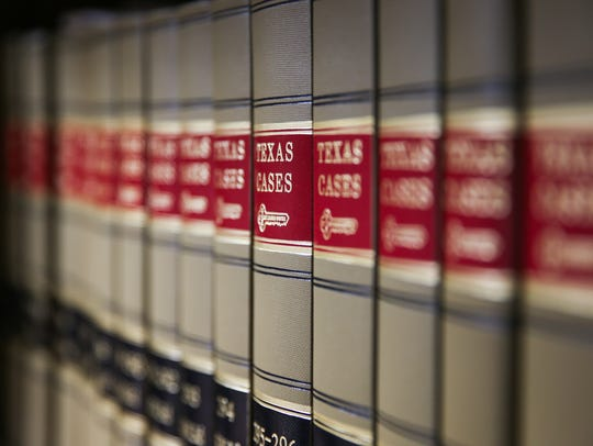 Texas Cases books fill the library at the office of