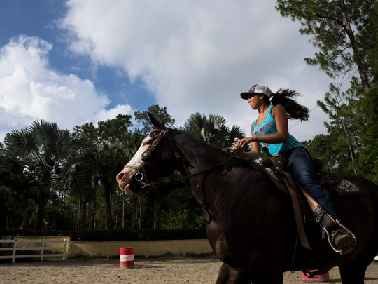 Rachel Caprio, 18, rides her horse Untouchable Black Star through basic barrel patterns at her home in Naples on Friday, July 21, 2017. After a big win in May 2015, at an event put on by the International Barrel Racing Association in Ocala, Rachel joined the junior division of the Women's Professional Rodeo Association.