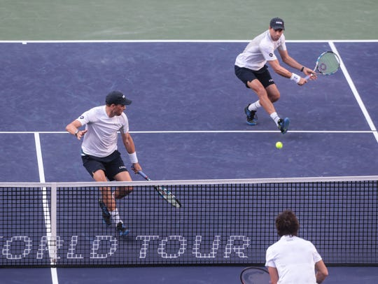 The Bryan Brothers Bob and Mike, left, advance to the
