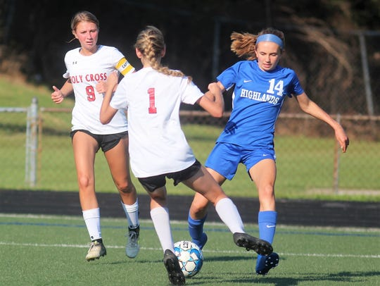 Holy Cross sophomore Kylie MacDonald pokes the ball