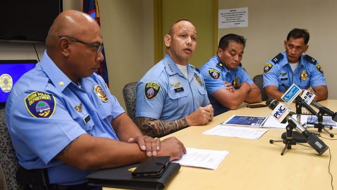Chief of Police Joseph I. Cruz, center, is flanked by ranking officers of the Guam Police Department as he talks about crime trends during a press conference at the agency's headquarters in Tiyan on Thursday, Jan. 18, 2018.