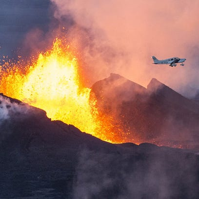 A plane flies over the Bardarbunga volcano on Sept. 14 on Iceland.spewing lava and smoke in southeast Iceland.