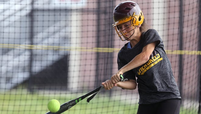 Tuloso-Midway softball player Jasmine Fernandez participates in batting practice on Wednesday, May 17, 2017.