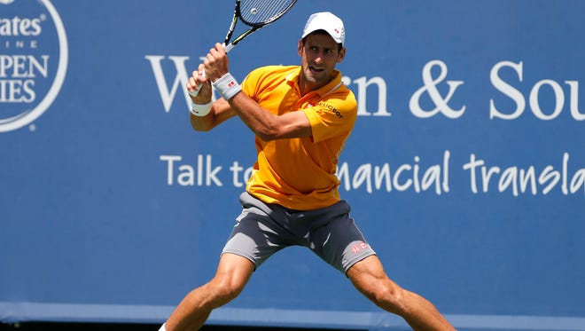 Novak Djokovic returns a shot against David Goffin (not pictured) on day six during the Western and Southern Open tennis tournament at Lindner Family Tennis Center in Mason.
