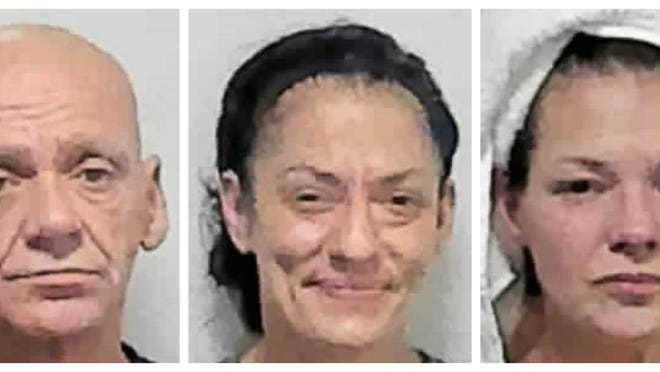 From left, Michael Demers, 56, who is homeless, Leann Souza, 30, of Middleboro, and Nicole Medeiros, 42, of Taunton, were arrested during a drug raid in Norton, Wednesday, Aug. 5, 2020.