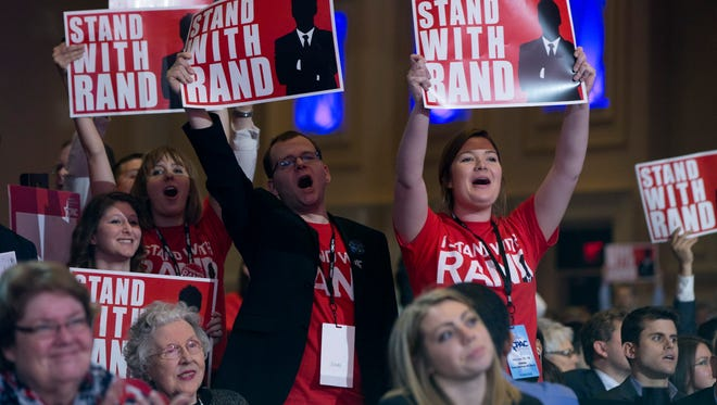 Supporters of Sen. Rand Paul cheer as he speaks during the Conservative Political Action Conference in National Harbor, Md., on Feb. 27.