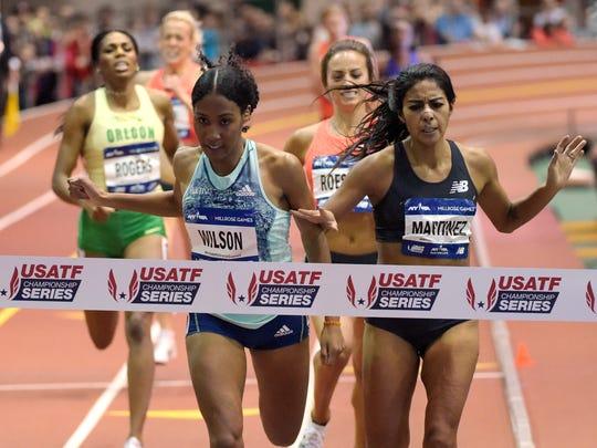 Ajee Wilson (left) defeats Brenda Martinez to win the