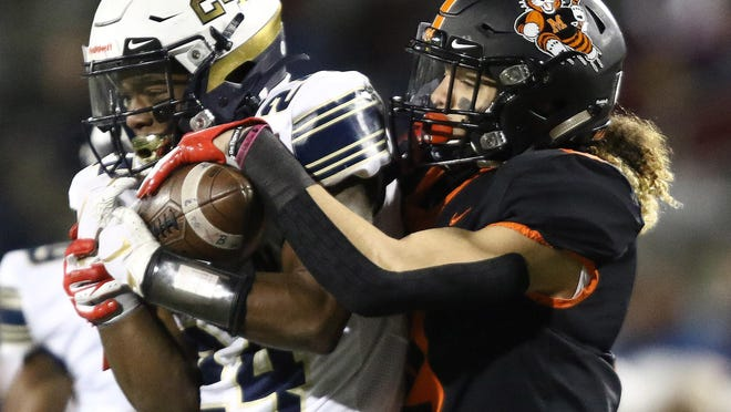 Massillon's Jayden Ballard battles for a pass with Hoban's Cordell Cobb in the first half of the teams' 2019 regional final game. Those teams wouldn't potentially meet until the state semifinals at the earliest this year due to the reformatted regions.