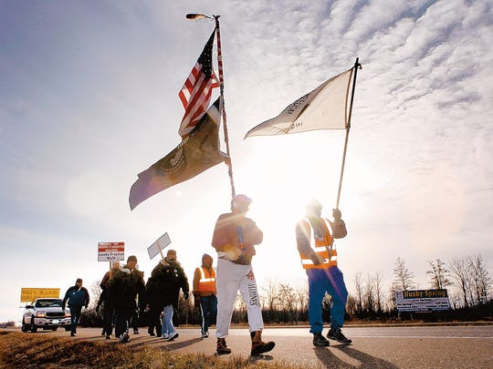 Jerry Wetterling, right, leads a group of walkers Dec. 19, 2004, on Stearns County Road 75 into St. Joseph. It was the last part of a 60-mile journey that began in Anoka to mark the ongoing search for answers in the abduction of Jacob Wetterling.