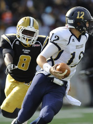 Alabama State's Daerius Washington (8) chases Stillman's  Josh Straughan (12) in the Turkey Day Classic on the ASU campus in Montgomery, Ala., on November 22, 2014. Stillman College is ending its football program.