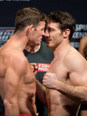 Middleweight Michael Bisping, left, of England, pushes his nose against opponent Tim Kennedy during the weigh-in for their fight earlier this year.