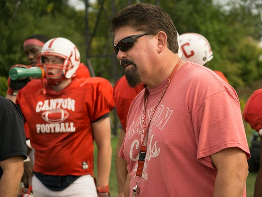Getting a point across during Tuesday's practice is veteran Canton head football coach Tim Baechler.
