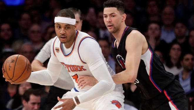 LA Clippers' Austin Rivers (25) defends New York Knicks' Carmelo Anthony (7) during the Wednesday's game.