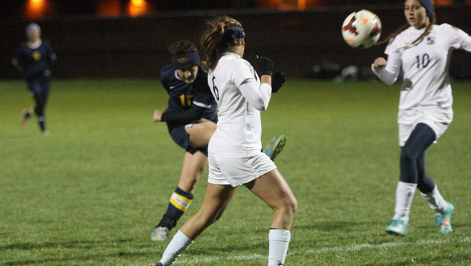 Woodmore's Maddy Hines fires a shot on goal against Archbold.