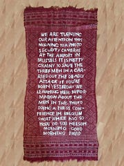 """Norm Magnusson's """"Siri translates NPR report on bombing of Brussels Airport,"""" Syrian cotton muslin on a prayer carpet, is included in """"Radius 50."""""""