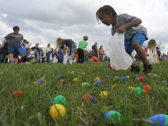 Children gather up Easter eggs during the annual Indianola Egg Drop on April 15 at the National Balloon Classic Balloon Field. The event was sponsored by the Indianola First Assembly of God Church, the National Balloon Classic, Racom, T.R.M. Disposal and Jim's Johns.