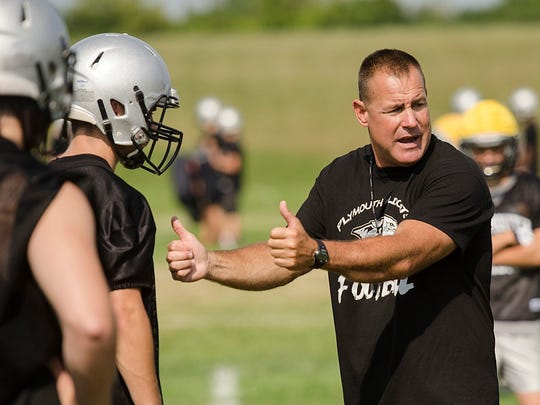 Mike Sawchuk, shown in a file photo at Plymouth (Mich.) High football practice, will be Naples' co-defensive coordinator with Cliff Greer next season. Sawchuk, a Naples graduate, was head coach at Plymouth for 12 seasons.