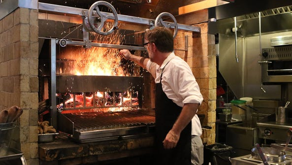 Executive chef Mark Jensen works the oven at Lexington,