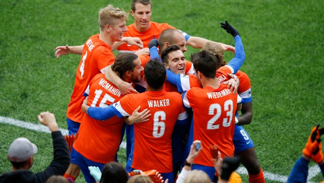FC Cincinnati celebrates FC Cincinnati midfielder Jimmy McLaughlin's (20) goal in the first half during the USL soccer game between the Pittsburgh Riverhounds and FC Cincinnati, Saturday, May 14, 2016, at Nippert Stadium in Cincinnati.