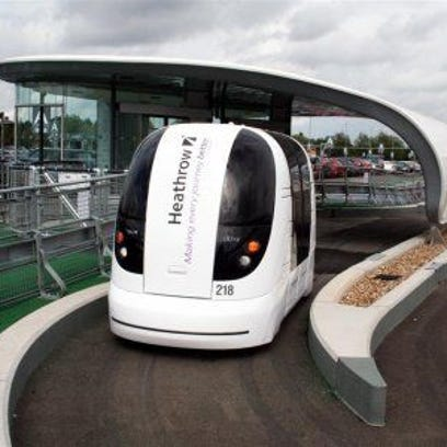 Riders aboard a PRT podcar in Masdar City, Abu Dhabi.