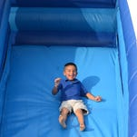 A slide and bouncy house were among the activities available for children Sunday at the Celebrate America picnic at Temple Baptist Church.