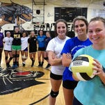 The Milton Panthers, District 1-6A volleyball champions, are getting ready for another season and the defense of their title. (foreground right front to back) Ashely Matthews, 16, Mikaela Worley, 17, and Hayley Cauley, 15.