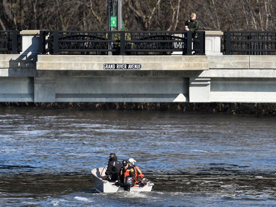 Members of the Capital Area Dive Team continue their search for a man gone missing late Wednesday morning, Feb. 28, 2018, after it was reported he had fallen in the Grand River Tuesday.