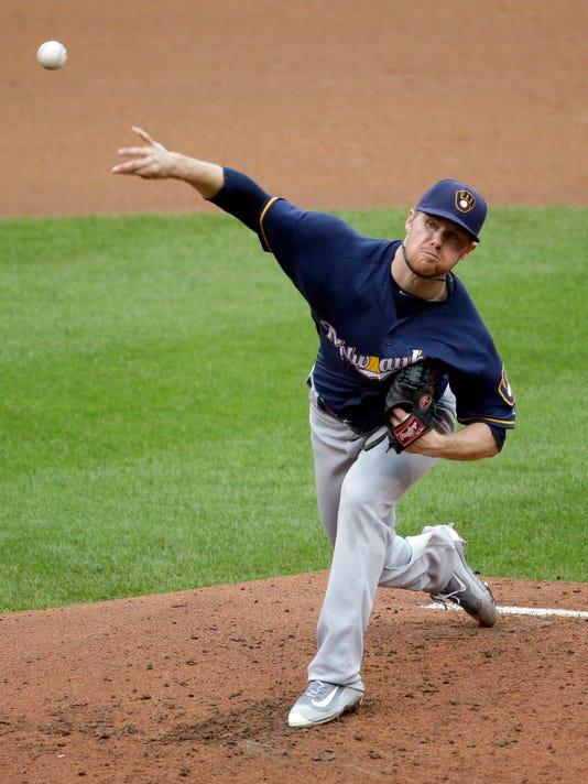 Milwaukee Brewers starting pitcher Chase Anderson throws during the third inning of a baseball game against the St. Louis Cardinals Sunday, July 3, 2016, in St. Louis. (AP Photo/Jeff Roberson)