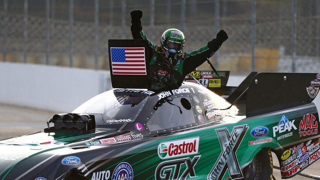 John Force celebrates after winning the Funny Car event at the NHRA Winternationals on Feb. 9.