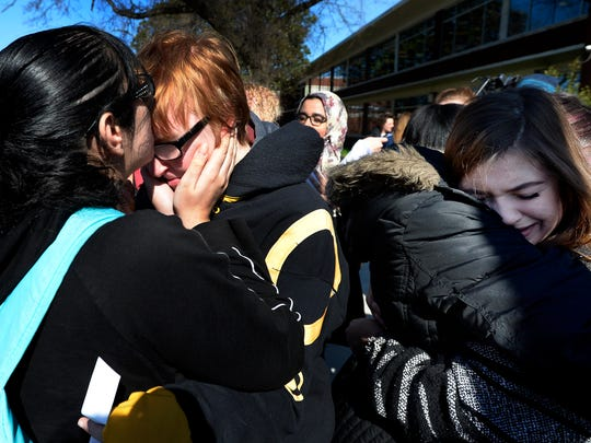 Maria Jowadi, left, kisses Kyle Kilgo after students protested against gun violence on school campuses and walked out of classes at John Overton High School on Wednesday, March 14, 2018, in Nashville Tenn. The walkout was part of a national student movement to protest for 17 minutes, one minute for each victim in the Parkland school shooting in Florida.