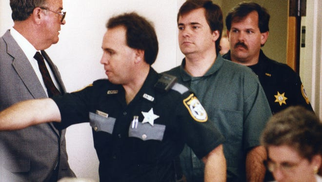 In this March 22, 1993 file photo, Public Defender Earl D. Loveless , left, watches as Michael Griffin is escorted into a courtroom for a hearing in the murder trial of Dr. David Gunn. At a hearing Wednesday, Nov. 1, 2017 in Tallahassee, Fla., the Florida State Commission on Offender Review set a March 9, 2043, release date for Griffin, who was convicted of shooting Dr. David Gunn on March 10, 1993, as Gunn arrived to work at an abortion clinic in Pensacola, Fla. (Bruce Graner/Pensacola News Journal via AP, File)