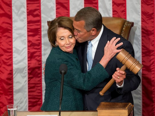 House Speaker John Boehner of Ohio, kisses House Minority