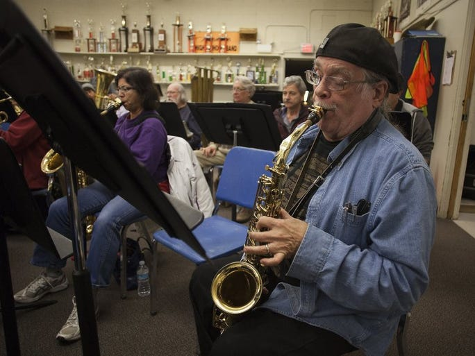 TROY HARVEY/SPECIAL TO THE STAR Tom Scharf plays his alto saxophone as the Gold Coast Wind Ensemble rehearses at Hueneme High School for Saturday's pops concert in Thousand Oaks.