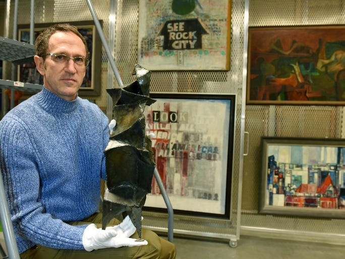 """Curator Stephen Wicks shows a sculpture by Philip Nichols titled """"Form in Steel #9"""" on Friday, Jan. 22, 2016, at the Knoxville Museum of Art. The work will be included in the Knoxville 7 exhibit which opens Jan. 29. According to Wicks, """"Form in Steel #9"""" is one of only a few known sculptures by Nichols from the 1960s, before he began working in stainless steel for its durability and brilliant finish.  Its mechanized anatomy reflects the artist's interest in modern technology such as robotics, artificial intelligence, and space exploration."""