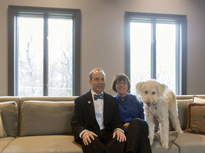 Barry and Annette Winston are joined on their living room sofa by Molly, a Tibetan Terrier Sheltie Mix.